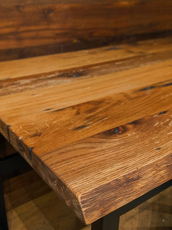Close up photo of reclaimed desk top