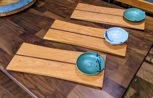 bread board and dipping bowl