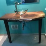 Live Edge walnut vessel sink in hall bath